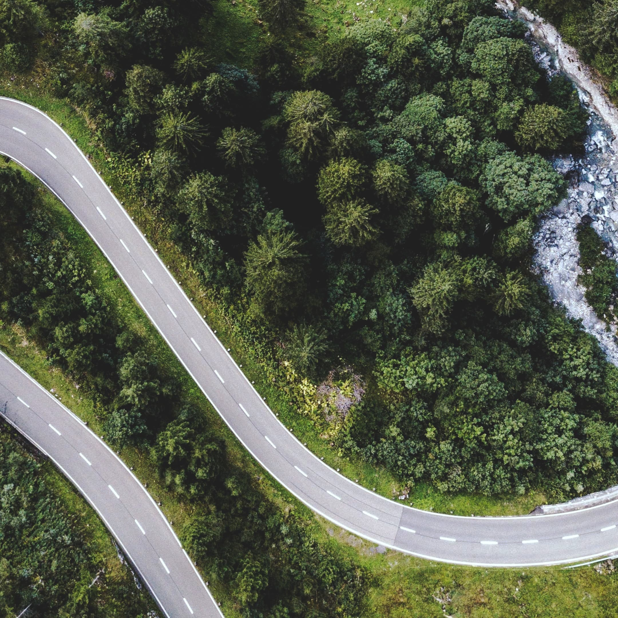 Birdview of an amazing hilly road, discover more roads like this on Road Trips by TomTom